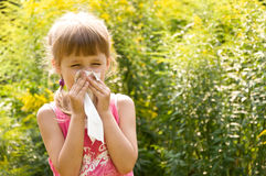 Girl is allergic to flowers Royalty Free Stock Image
