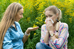 The girl is allergic to pollen of flowers Stock Photography