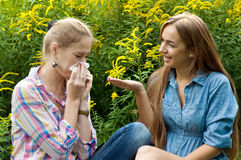 The girl is allergic to pollen of flowers Royalty Free Stock Image
