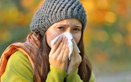 Girl with allergy or cold using tissue Royalty Free Stock Photos