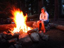 Girl Alone by Campfire While Camping Stock Photography