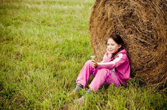 Girl alone in meadow Royalty Free Stock Image