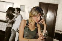 Girl alone in a pub stock photo
