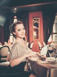 Girl alone in a restaurant Royalty Free Stock Photography