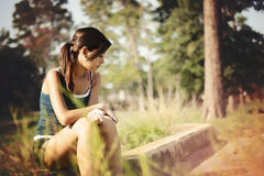 Girl alone thinking in a park Royalty Free Stock Photography