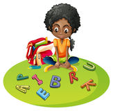 Girl with alphabet blocks Stock Image