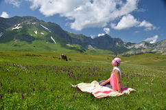 Girl in an Alpine meadow Royalty Free Stock Image