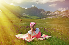 Girl in an Alpine meadow Stock Photo