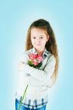 The girl  with an alstromeriya Stock Image