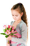 Girl  with an alstromeriya Royalty Free Stock Photo
