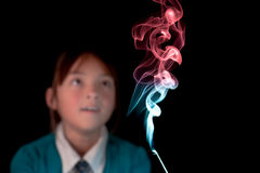 Girl amazed by the smoke. Royalty Free Stock Images