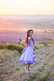 Beautiful girl in a field of lavender on sunset. stock image