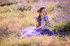 Beautiful girl in a field of lavender on sunset. royalty free stock images