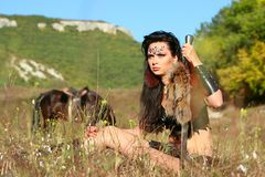 Girl amazon warrior armed with a sword Stock Images