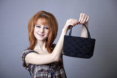 Girl in american 50s-60s style. Girl in american 50s-60s style with handbag stock images