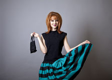 Girl in american 50s-60s style with handbag. Royalty Free Stock Photo