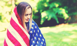 GIrl with an American flag on the fourth of July Stock Photo