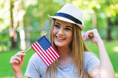GIrl with an American flag on the fourth of July Royalty Free Stock Images