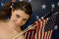 Girl with American flags. Pretty girl with American flags ready to celebrate the 4th of July Stock Photo