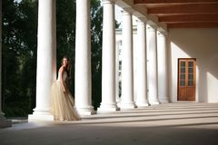 Girl amongst colonnades Stock Images