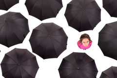 Girl amongst umbrellas Stock Images