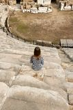 Girl in the amphitheater Stock Photography