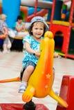 Girl in the amusement park Stock Photos