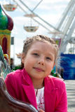 Girl in amusement park Royalty Free Stock Images