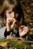 Girl analyzing leaf Royalty Free Stock Photos