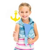Girl with anchor and flag Stock Photography