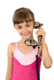 The girl and ancient phone Royalty Free Stock Photos