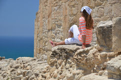 Girl among ancient ruines Royalty Free Stock Image