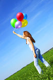 Girl And Balloons Royalty Free Stock Images
