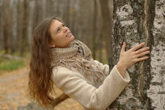 Girl And Birch Tree Stock Photography
