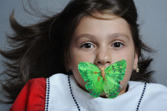 Girl And Butterfly Royalty Free Stock Photography