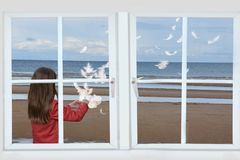 Free Girl And Dancing Feathers Seen  Through The Window Royalty Free Stock Photos - 159259708