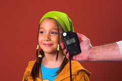 Girl And Flash Meter Royalty Free Stock Images