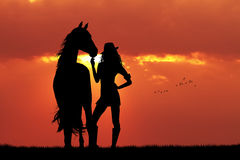 Girl And Horse Silhouette At Sunset Stock Photo
