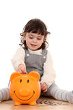 Girl And Piggy Bank Stock Photos