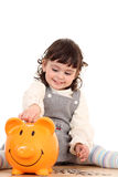 Girl And Piggy Bank Stock Image
