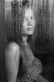 Girl And Rainy Window Royalty Free Stock Images