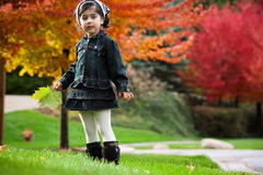 Girl And Red Autumn Trees Stock Photography