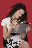 Girl And Tablet Pc Stock Photography