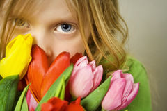Girl And Tulps Royalty Free Stock Photos