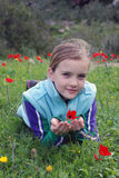 Girl and anemone Royalty Free Stock Photos
