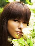Girl ang flowers Royalty Free Stock Photography
