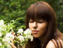 Girl ang flowers Stock Photos