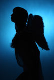 Girl angel. Silhouette of a girl angel Stock Photo