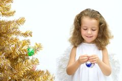 The girl - angel. Decorating a christmas tree Stock Photo