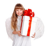 Girl in angel costume with gift box. Girl in angel costume with white gift box Royalty Free Stock Images